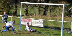 Steff Richards in action v Montgomery Town
