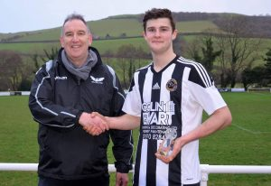 Tom Evans receiving his Player of the Month award for November